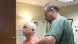 Scottsdale chiropractor treating spinal injury on an older gentleman